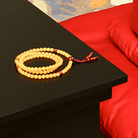 Buddhist Prayer Beads - On a Puja Table