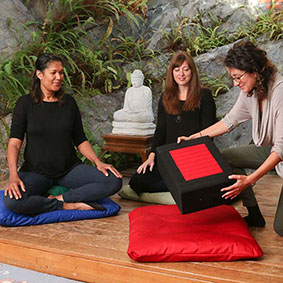 Gomden Meditation Cushion - In black with red center. A rectangular cushion for comfortable cross-legged meditation